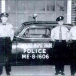 Historic Photo of officers and patrol car
